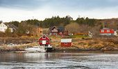Traditional Norwegian Village With Wooden Houses On Seacoast