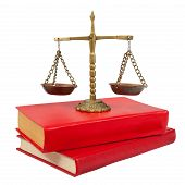 stock photo of law-books  - Scales of justice atop legal books over white - JPG