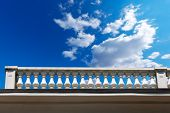 stock photo of balustrade  - Old white stone balustrade with blue sky and clouds in the background - JPG