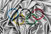 stock photo of olympiad  - Satin flag with emblem the olympic rings - JPG