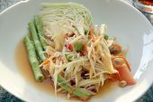 picture of green papaya salad  - green papaya salad in white dish on the foods table - JPG
