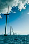 picture of wind-farm  - Windmills in a row vertical denmark oresund baltic sea - JPG