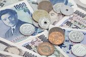 image of yen  - Close - up japanese yen bank note and japanese coin