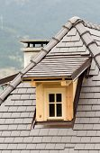 picture of gabled dormer window  - Wooden dormer on tiled roof on mountain house