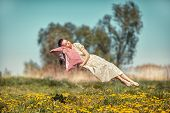 image of sleeping beauty  - Girl hovers and sleeps on a pillow over a beautiful meadow - JPG