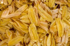 image of crip  - Deep fried sweet banana chips or dried slices of bananas Sweetened - JPG