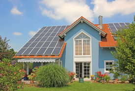 picture of gable-roof  - modern new built house and garden rooftop with solar cells blue front with lattice window - JPG