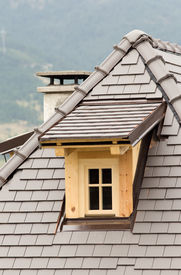 stock photo of gabled dormer window  - Wooden dormer on tiled roof on mountain house  - JPG