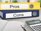 stock photo of disadvantage  - pros and cons binders isolated on the office table - JPG