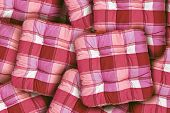 stock photo of piles  - Plaid Red Square Cushions pile as home interior decoration background - JPG