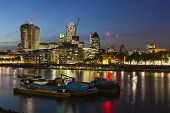 stock photo of london night  - Night view over the Thames River in London to the city with several new skyscrapers - JPG