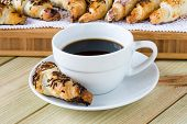 stock photo of croissant  - coffee cup with croissants on wooden table - JPG