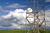 picture of utility pole  - electricity high voltage metal pole on summer evening farmland field - JPG