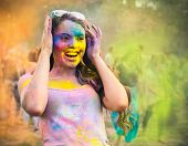 stock photo of holi  - Portrait of happy young girl on Holi color festival - JPG
