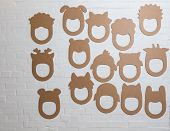 foto of laughable  - Set of cardboard masks on a white brick wall - JPG
