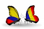 stock photo of chad  - Two butterflies with flags on wings as symbol of relations Columbia and Chad Romania - JPG