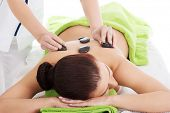 foto of stone-therapy  - Girl on a stone therapy - JPG