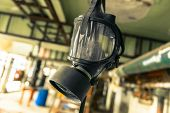 pic of trooper  - Gasmask hanging from cieling in abandoned interior - JPG
