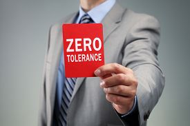 stock photo of zero  - Showing a zero tolerance red card concept for bad business practice - JPG
