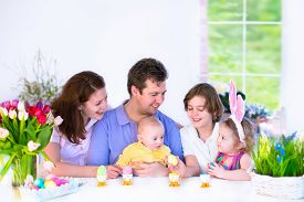 stock photo of big-girls  - Happy young family with three children  - JPG
