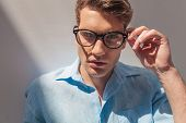 picture of take off clothes  - Close up picture of a handsome casual man taking off his glasses - JPG