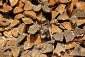 stock photo of firewood  - Chopped firewoods stacked in rows - JPG