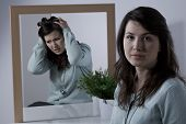 foto of emotional  - Young emotionally unstable woman with bipolar disorder - JPG