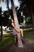 image of jamaican  - Stock image of a Jamaican model posing by a tree in the park - JPG
