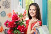 stock photo of flower shop  - Young girl holding flowers and shopping in a clothes store - JPG