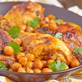 stock photo of curry chicken  - Curry Chicken With Chickpeas on a table - JPG