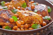 pic of curry chicken  - Curry Chicken With Chickpeas on a table - JPG