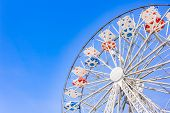 picture of color wheel  - Ferris Wheel at the county fair with the sky in the background - JPG