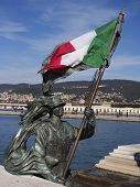 stock photo of italian flag  - The italian flag on the statue of a bersagliere  - JPG