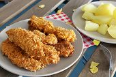stock photo of boil  - chicken strips on plate and boiled potatoes - JPG