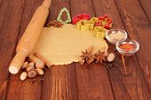 foto of christmas spices  - Christmas dough with cookie cutters - JPG