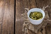 picture of jalapeno  - Heap of sliced Jalapenos on rustic wooden background - JPG