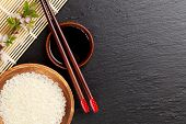 picture of soy sauce  - Japanese sushi chopsticks over soy sauce bowl - JPG