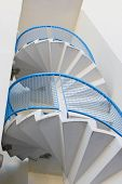 pic of spiral staircase  - External metal spiral staircase fire escape in sunlight - JPG