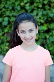 foto of  preteen girls  - Happy preteen girl with blue eyes smiling at outside - JPG