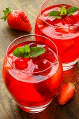 foto of refreshing  - Refreshing summer drink with Strawberry in jug and glasses on the vintage wooden table