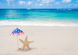 pic of starfish  - Patriotic USA background with starfishes and decorations on the sandy beach - JPG