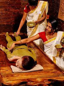 pic of panchakarma  - Young woman having body Ayurveda spa massage - JPG