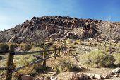 stock photo of split rail fence  - A split rail fence running across the desert toward distant mountains - JPG