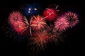 Постер, плакат: Red Golden Blue Fireworks Over Night Sky