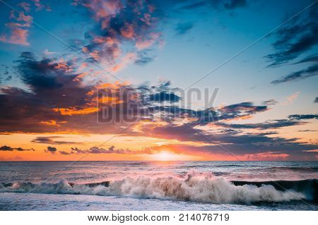 poster of Sun Is Shining Over Horizon At Sunset Or Sunrise. Evening Sea Or Morning Ocean. Sea Ocean Waves In Colorful Sunset Sunrise Sky Lights. Natural Sky Warm Colors.