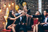 Cheers! Group Of Friends Clinking Glasses Of Champagne During Party Celebrating poster