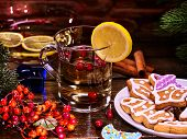 Christmas gluhwein glass mug and Christmas multicolored cookies on form stars on plate with fir bran poster