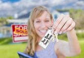 Woman Holding New House Keys with Your Home Sweet Home Card In Front of Sold Real Estate Sign and Ho poster