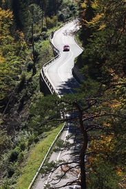 picture of long winding road  - a picture of a long and winding road in the Alps - JPG