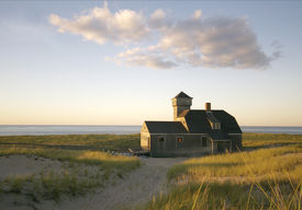 stock photo of cape-cod  - This Edward Hopper-esqe image is of the Old Harbor Lifesaving Station built in 1897 in Chatham and moved to Provincetown in 1978.  - JPG
